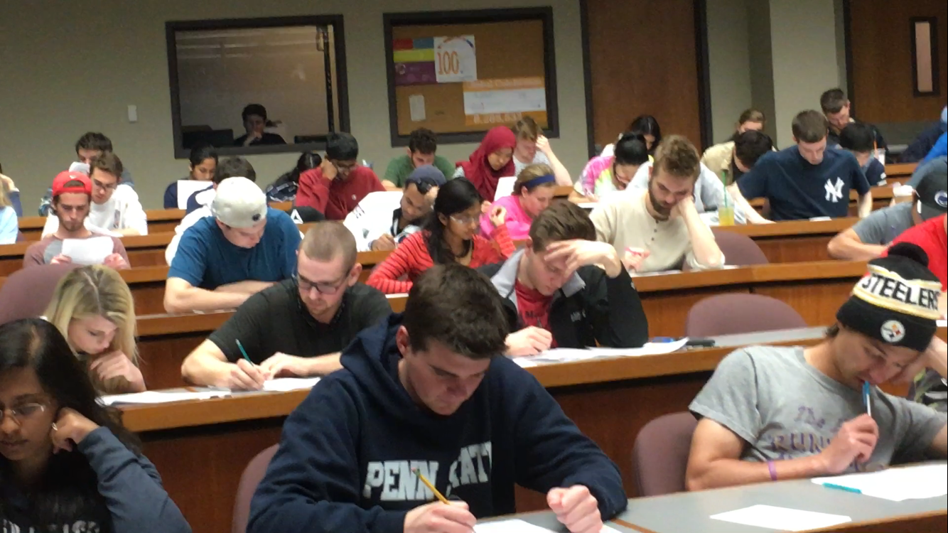 Students taking an exam in BMB 484